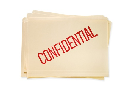 Stack of manilla file folders, stamped confidential.   photo