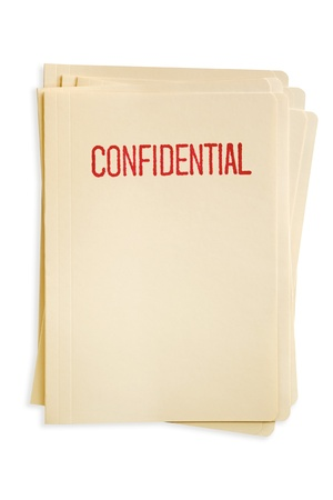 manila: Stack of manilla file folders, stamped confidential.