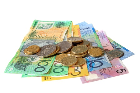 Australian notes and coins, over white background. photo