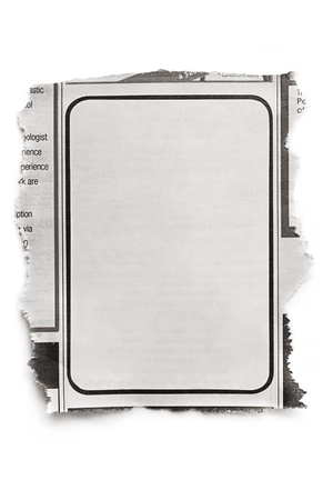 torned: Blank newspaper ad, ready for your text   Isolated on white with natural shadow  Editorial