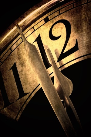 12 hour: Clock showing two minutes to midnight   Golden hues, with grunge effects
