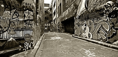 Graffiti-covered walls in old alley   Hosier Lane, Melbourne, Australia  High contrast, black and white  photo