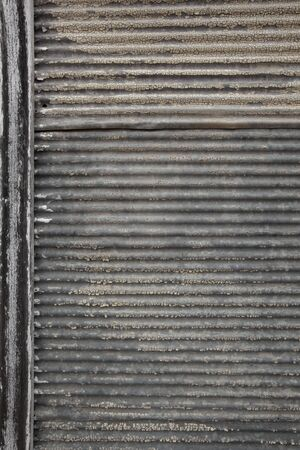 corrugated: Old corrugated iron with rust and cracked peeling paint   Great grunge textures