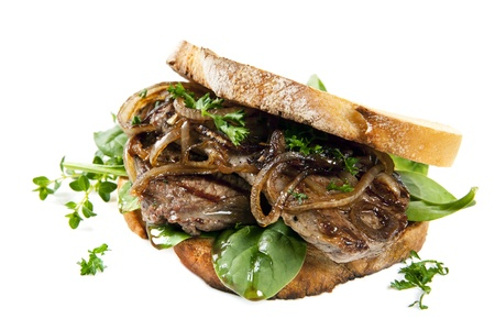 Steak sandwich with onions and spinach, over white background  photo