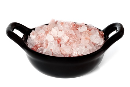 mineral salt: Special pink salt from the Himalayas, in a small black bowl isolated on white  Stock Photo