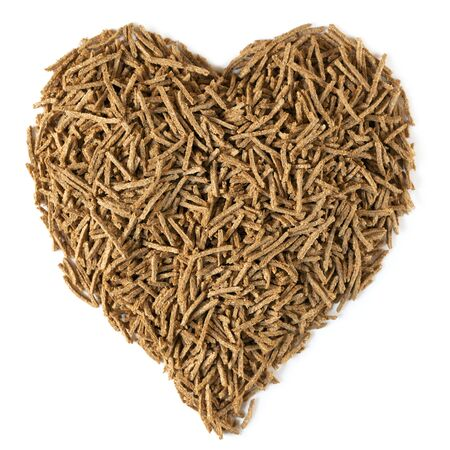 bran: Bran in a heart shape, isolated on white   Dietary fiber is beneficial for heart health