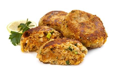 potato tuna: Salmon fishcakes or patties, with lemon and parsley, isolated on white background