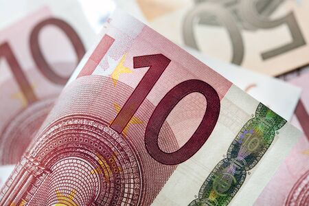 Euro notes in full-frame, with focus on front ten Euro note Stock Photo - 13452838