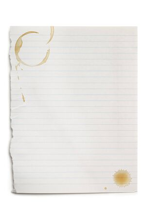 Torn white notepaper with coffee stains, isolated on white with soft shadow  photo
