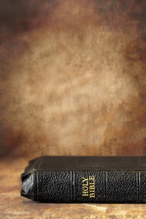 holy bible: Old Holy Bible, over a grunge stone background   Lots of copyspace