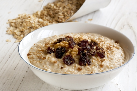 Porridge with walnuts, raisins and brown sugar.  Delicious oatmeal. photo