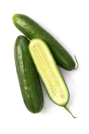 Lebanese cucumbers isolated on white.  Overhead view. Stock Photo - 14240198