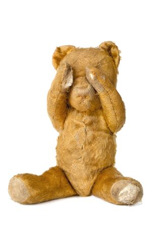 teddybear: Vintage teddy bear covering eyes, isolated on white background