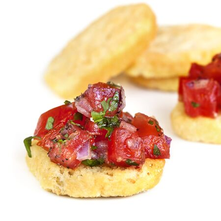 Mini bruschetta appetizers, on crispy crostini  photo