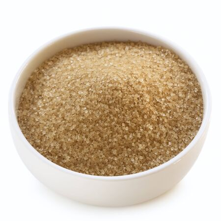Bowl of raw sugar isolated on white background.  Granulated cane sugar, also called demerara. Stock Photo - 14641480