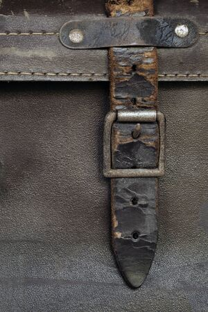old leather: Old buckle and leather strap on vintage suitcase.