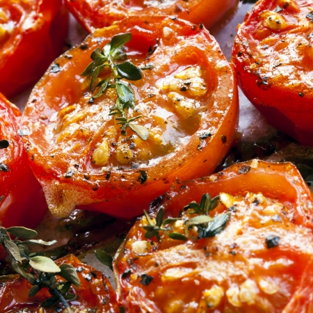cherry tomato: Roasted cherry tomatoes with herbs, on a baking tray straight from the oven