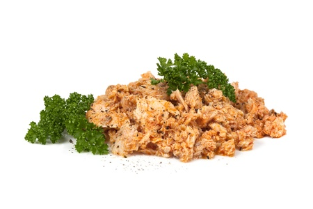 Canned tuna on white background, with parsley and cracked black pepper. photo