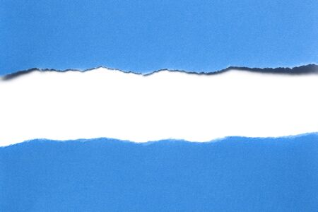 Blue paper torn in half, with white paper beneath.  Horizontal strip makes perfect copy space. photo