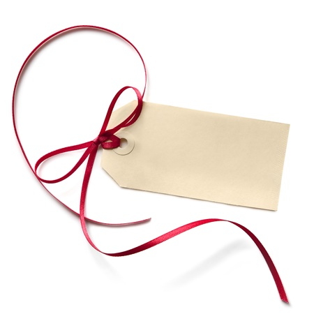 Blank gift tag with a red ribbon bow, isolated on white  photo