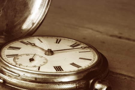 hands in pockets: Vintage pocket watch over old timber   Sepia tone, lots of dust  Stock Photo