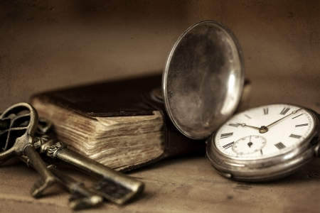 still life: Vintage grunge still life with pocket watch, and old book and brass keys