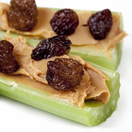Ants on a log   Celery sticks with peanut butter and raisins   Healthy snacking  photo