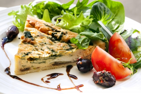 Spinach quiche with a healthy salad and balsamic glaze