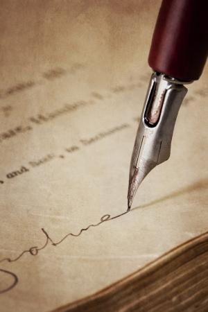 nib: Vintage nib pen, signing old paper.  Grunge effects.
