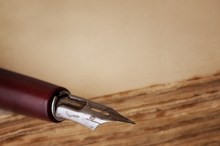 nib: Old nib pen on book, with copy space.
