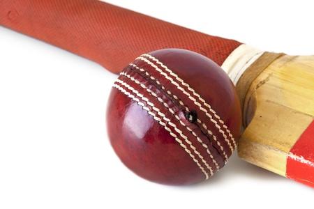 cricket bat: Old cricket bat and cricket ball, over white background