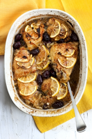 Baked lemon chicken with onions, thyme and black olives.  Delicious! Stock Photo