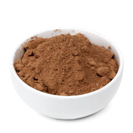 Small white bowl of cocoa powder isolated on white.   photo