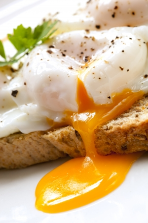 Poached eggs on toast, garnished with parsley