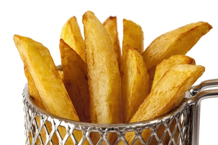 small basket: French fries or potato chips in a small wire frying basket, over white background