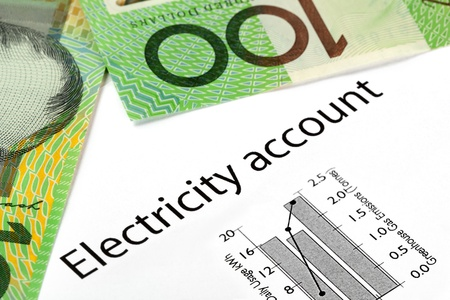 electricity: Electricity account showing increasing usage and greenhouse gas emissions, with Australian one hundred dollar bills