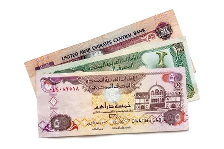 arabic currency: United Arab Emirates dirham banknotes, isolated on white background