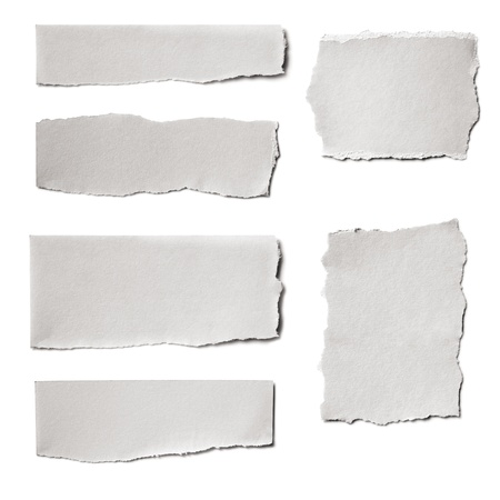 Collection of white paper tears, isolated on white with soft shadows