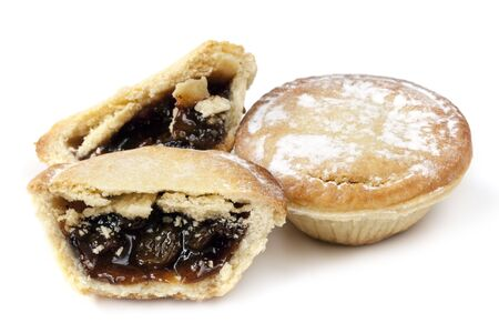 minced pie: Two mince pies, isolated on white background   One whole and the other cut   Traditional Christmas fare  Stock Photo