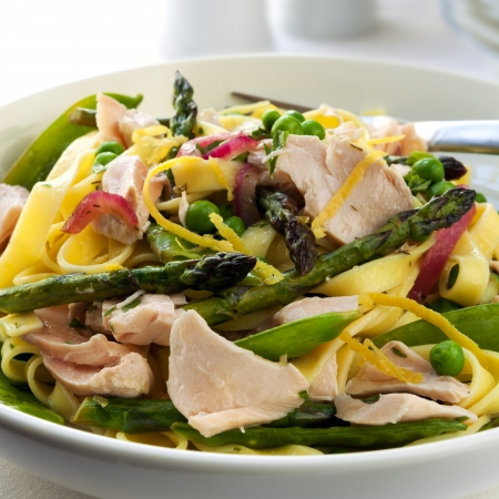 flaked: Pasta primavera made with linguine and fresh flaked salmon.