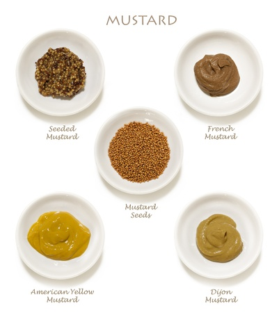 wholegrain mustard: Collection of mustards, isolated on white.  Includes wholegrain, Dijon, American yellow, French, and mustard seeds.