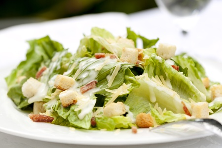 caesar salad: Healthy caesar salad, served al fresco  Stock Photo