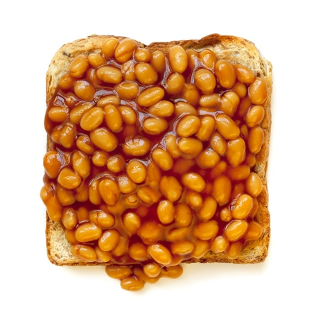 Baked beans on toast, isolated on white background   Overhead view