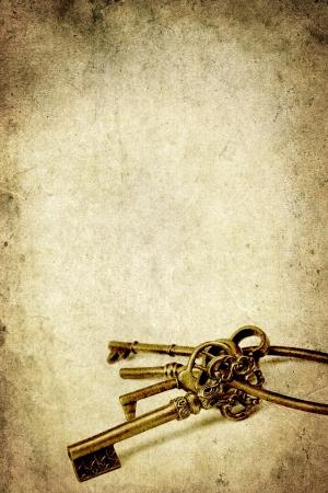 old key: Ring of Old Brass Keys over Grunge Background