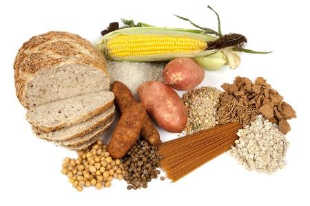 Voedsel bronnen van complexe koolhydraten, geïsoleerd op wit Stockfoto