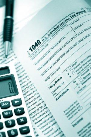US tax form 1040 with pen and calculator  Stock Photo - 17842628