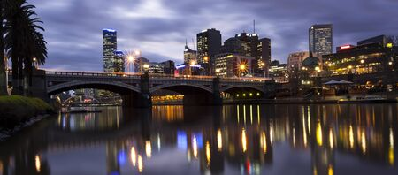 Melbourne, Australia, viewed across the Yarra River towards Princes Bridge. photo