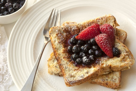 toast: French toast with berries.  Delicious blueberries and strawberries.