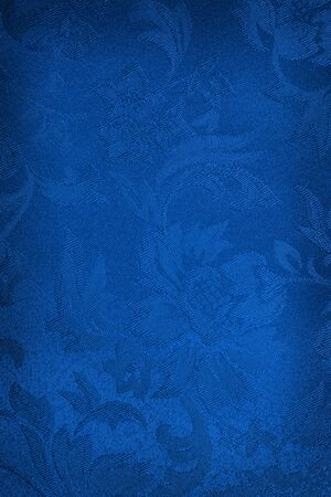 blue silk: Embroidered blue silk or damask background. Stock Photo