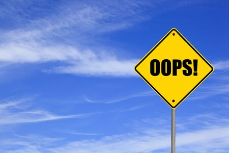 oops: Yellow road sign with the word oops! against blue sky. Stock Photo